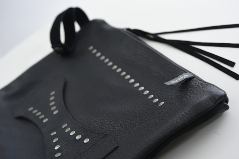 Closeup of the leather clutch with handle.