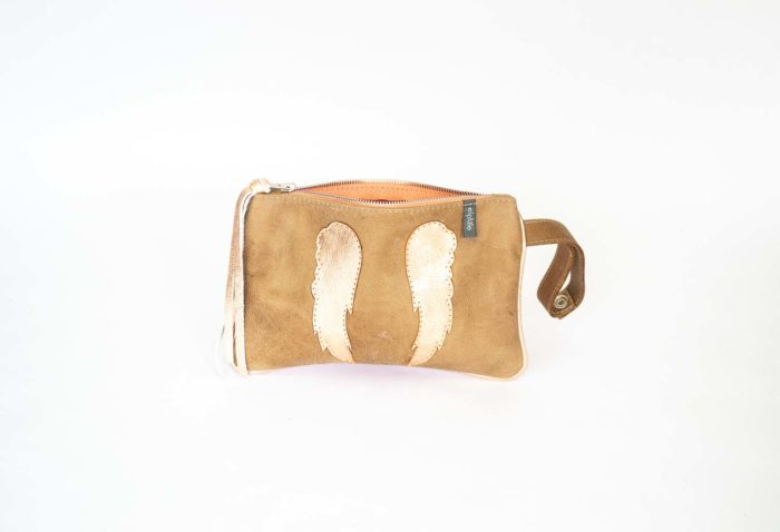 Wristet purse in tan and gold cowhide.