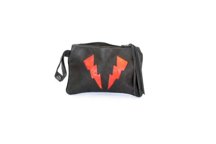 black handbag with red bolts