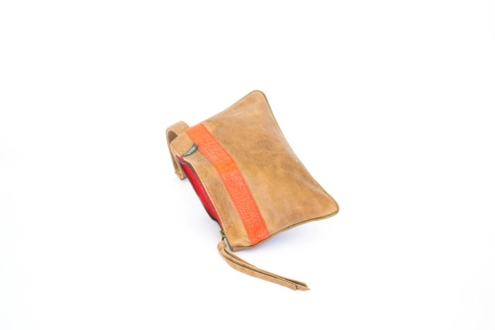 Woman handmade handbag in caramel leather