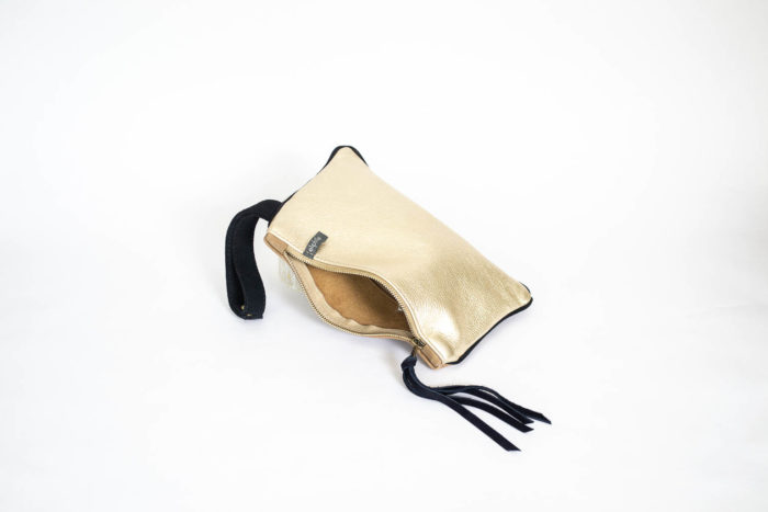 Clutch with wristlet strap in gold and brown