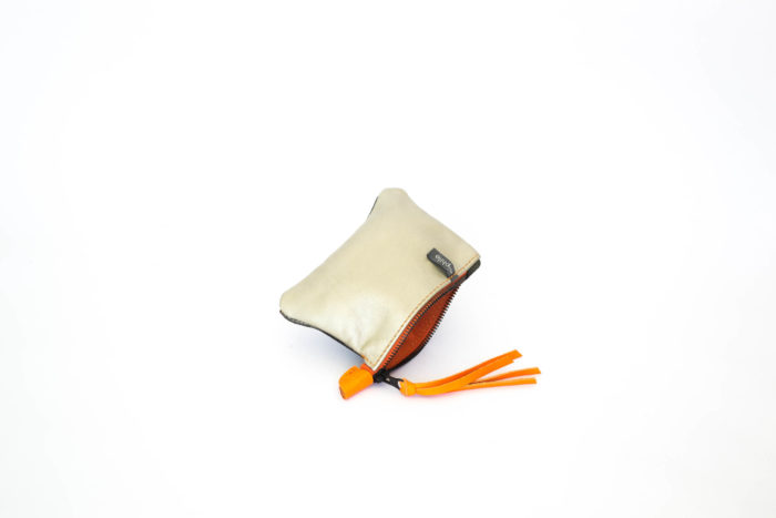 Ivory and bronze change pouch