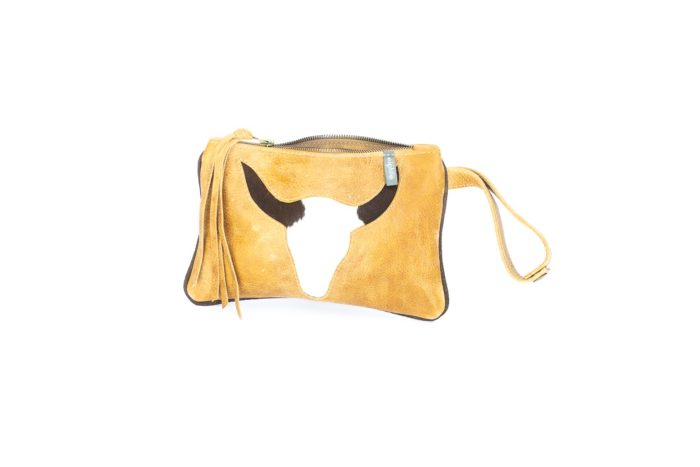 Wristlet bag featuring a longhorn in hair on cow print.