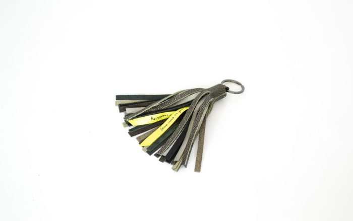 Tassel keychain made of grey and silver leather scaps.