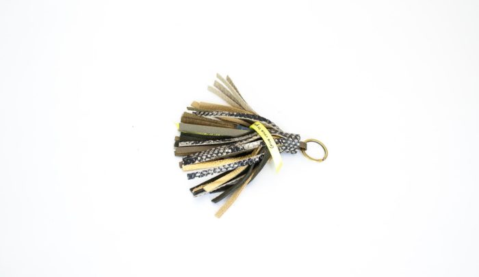 Keychain with tassel in python snake print and golden fringes.