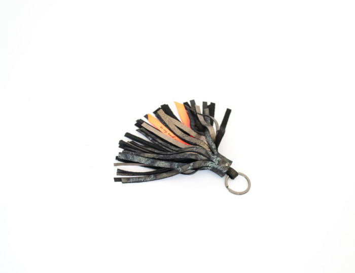 Keyring leather tassel in brown and leopard print textured leather with a neon ribbon.