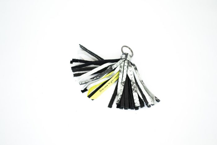 Tassel with keychain in Python print and black.