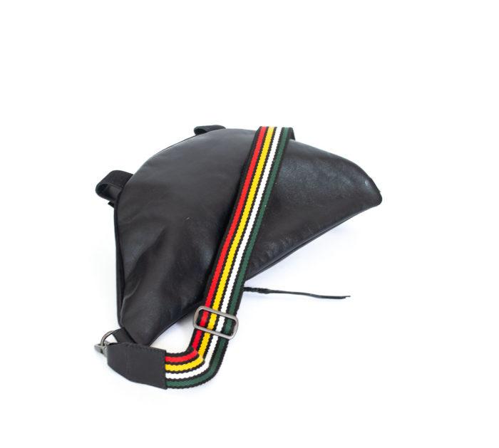 Back of the travel bag in black cowhide.