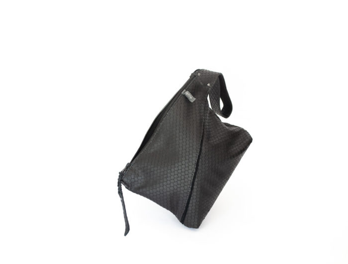 Picture of the front of the textured black Z clutch with a large zipper and handle.