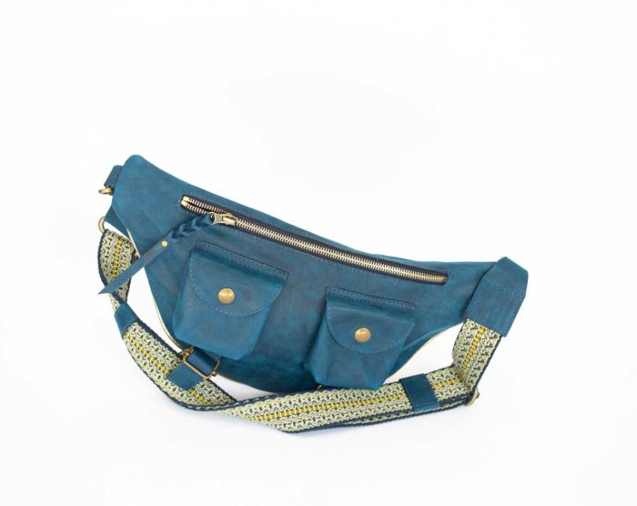 Picture of the colbat blue travel back with yellow-navy strap.