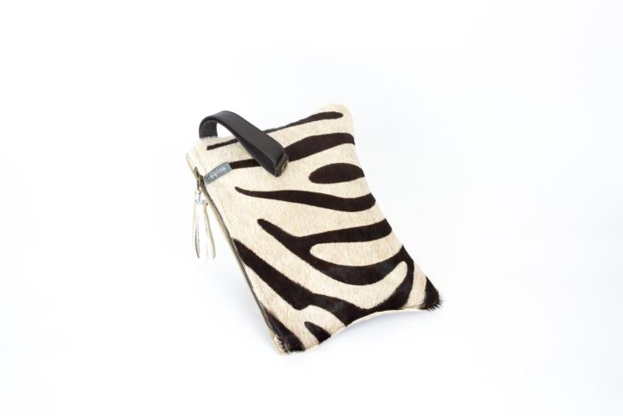 Picture of a beige zebra animal print small evening bag.