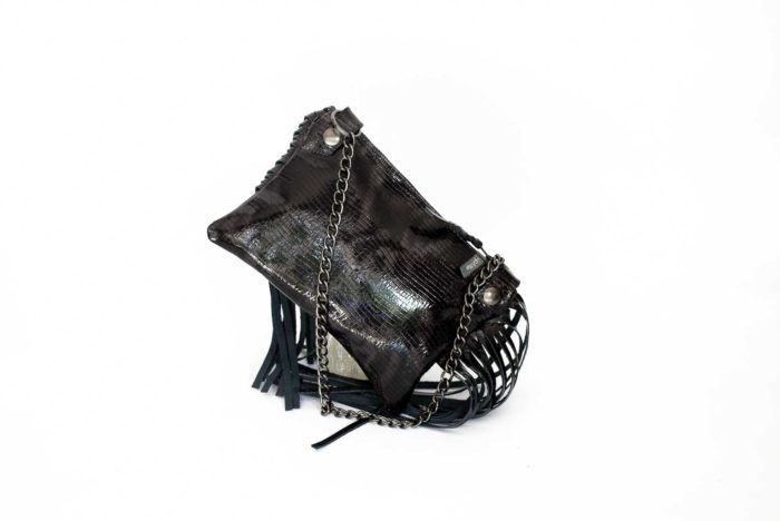 Close-up of the back of the black evening handbag with fringes and removable chain to wear it on the shoulder.