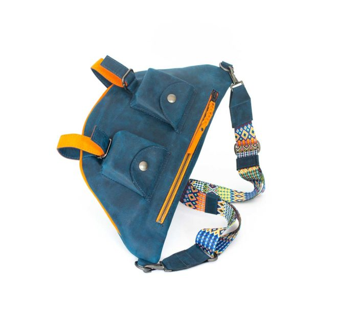 Picture of the front of the blue travel bag with its two front pockets and orange zipper..