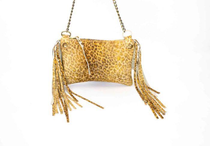 Close-up of a tan leopard print handbag.