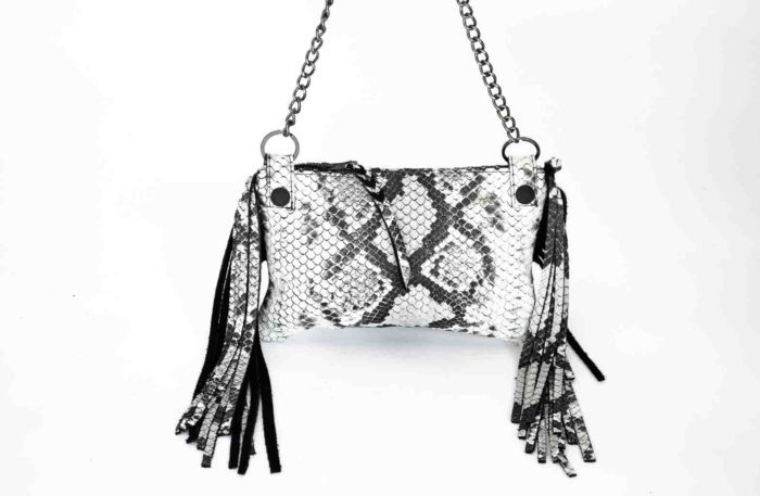 Image of the python print clutch with removable chained strap.