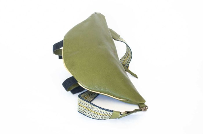 Picture of the back of the deep light green travel handbag.
