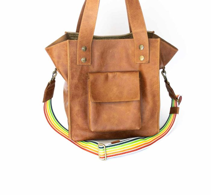 Picture of the cognac tote handbag with a rainbow strap.
