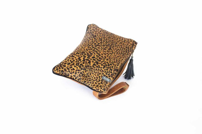 Close-up of the purse in leopard leather with zipper and cognac wristlet.
