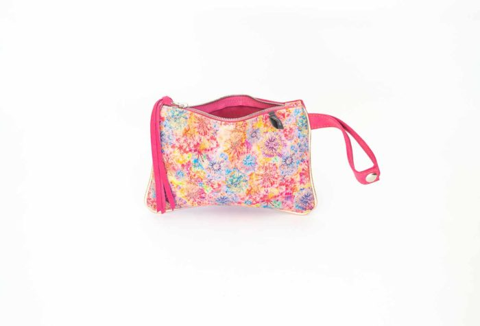 Picture of the tiny pink leather purse with zipper and wristlet.