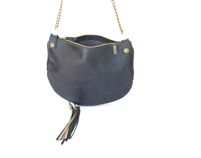 Image of the navy blue and gold gusset Parisian shoulder bag.
