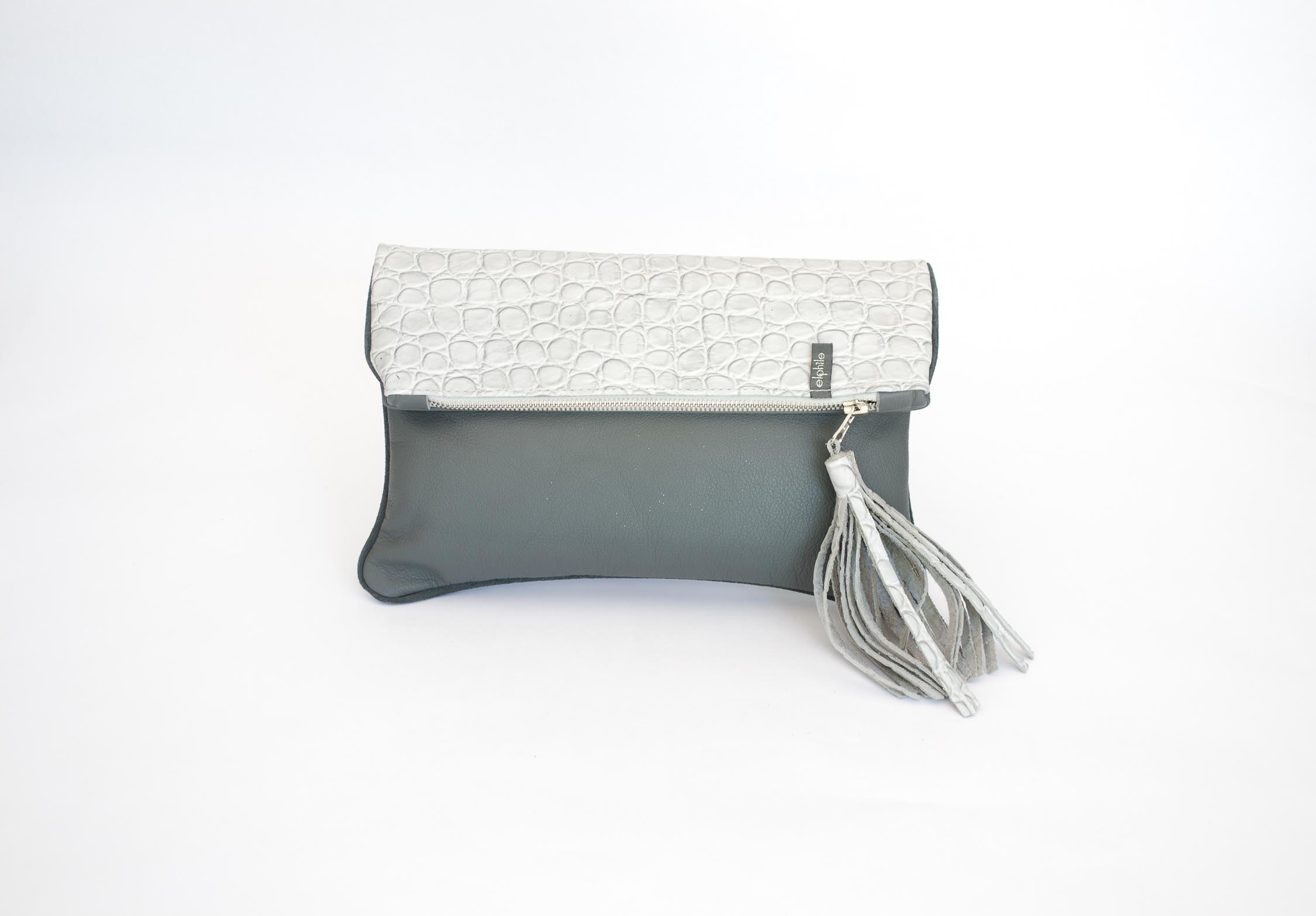 closeup of a light grey croco tile foldover bag